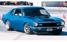1972 Ford Maverick, M's was this color, with big wide tires and jacked up in the back. Super fast.