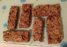 My pre workout, banana and oat bars!  All you need is 2 bananas and 2 cups of porridge oats!   Method:  1. Mush both bananas up until they're a thick paste consistancy.  2. Mix in the oats bit by bit (This is so they don't go everywhere). 3. Put in a square baking tray and put in a 200 degrees oven, gas mark 5 for 20-25 minutes.  4. Wait until crisp then remove from the oven, slice, and totally devour them!   You could add chocolate chips to this healthy treat for that little extra something