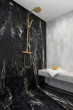 Marble Bathroom Shower Tiles At Ciot | Showcase the unique beauty and variations of natural stone by using it on floors and walls. Black Zebrino honed marble brings a dramatic bold look to a shower. When paired with brass fixtures and an adjacent contrasting stone wall, it offers a luxe, high-fashion vibe. | #sponsored