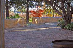 Ledge surrounding terrace / let's line the whole ledge with standard glass votives (tealights)