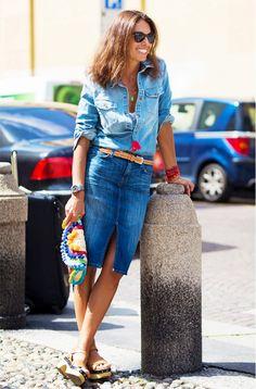 A denim button-down shirt is worn with a belted denim skirt and playful, colorful accessories | @andwhatelse