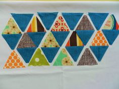 Molly Flanders Makerie: Pyramid Quilt tutorial. Great trick using strip piecing and FP ruler!