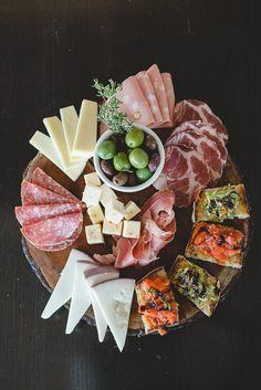 antipasto plate with cheese, meats, olives and bruschetta