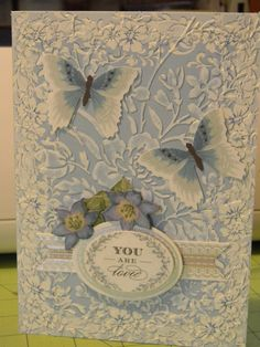 Lovely layers which have been embossed and sanded for a unique look using Anna Griffin products and florals by K & Co.
