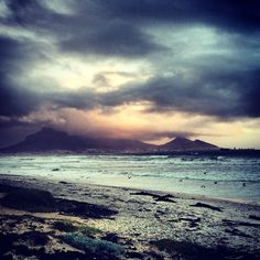 Sunset Beach, Cape Town, South Africa. The Beach would be cool, but my main reason for wanting to go to Africa would be the African Savannas and the wildlife!