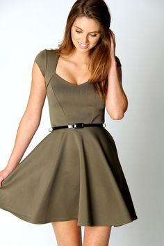 Sweetheart neckline skater dress. With this color I'd pair with black tights, booties, scarf, and sweater/ jacket for autumn.