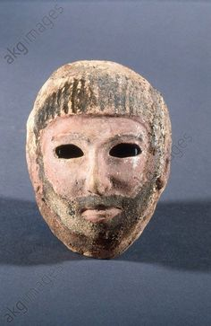Phoenician terracotta funerary mask, 8th century BC, Israel - Click on the images to visit the Historyteller website.