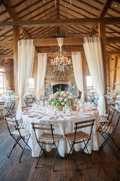 rustic barn wedding reception with fabric draping #wedding #weddingideas #barnwedding