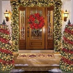 Wow!! I don't have enough space to do this at my house, but I love the garland around the door and the trees with the red-ball garland wrapped around it!!