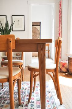 The chairs are original Thonet chairs purchased from the Eero Saarinen Concordia Campus in Fort Wayne, Indiana. The table is custom made by Scott at Rustic Elements Furniture. The rug was purchased in Morocco . The baskets are from Mexico and Senegal.