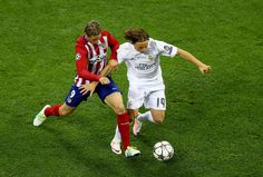 Fernando Torres of Atletico Madrid battles for the ball with Luka Modric of Real Madrid during the UEFA Champions League Final match between Real Madrid and Club Atletico de Madrid at Stadio Giuseppe Meazza on May 28, 2016 in Milan, Italy. (May 27, 2016 - Source: Clive Mason/Getty Images Europe)