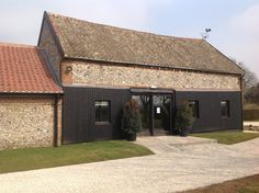 The Smaller Flint Barn and entrance.  Ideal for an intimate civil ceremony or perfect for a drinks reception after the church.