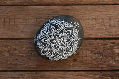 16. Hand Painted Mandala Beach Rock