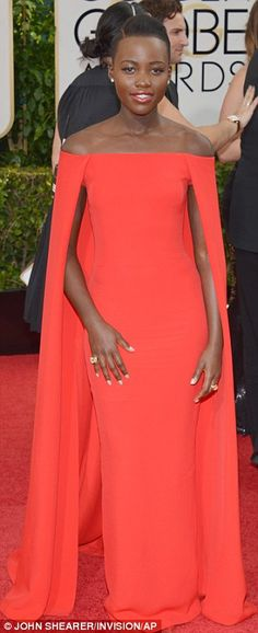 8d012e86f0d8 Lupita Nyong'o led the ladies in red in a bright coral Ralph Lauren cape