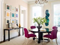 A neutral dining room is enlivened by a series of Josef Albers silkscreens and fuschia chairs in a Leilèvre fabric | archdigest.com