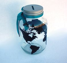 This bank is made to look just like the world globe. Great for someone who wants to save their money for travels all around the world. It is a quart size glass mason jar with an aluminum machine punched coin slot lid. The vinyl (color of the globe) and ribbon color is up to you!!  As always all items in my shop are customizable. If you like what you see, but wish it were a little different, please let me know. I can usually make it happen.  Do you wish this bank were bigger? I now offer my…