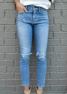 Citizens of Humanity's high rise skinny jeans take a tough turn with rough-and-rugged detailing, plus a faded-and-frayed medium blue wash for added downtown edge. Cut from the brands signature stretch denim, the Rocket crop jeans have a smooth, svelte silhouette and hold their shape beautifully. #denim #distressedenim #lightwashdenim #citizesofhumanity #COH