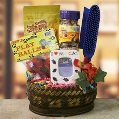 The Cats Meow  Pet Gift Basket - Cat    No use in crying over spilt milk, this Cat Gift Basket is the puurfect for any cat lover. The Cats Meow arrives with an adorable I Love My Cat photo frame, two packages of cat treats, package of colorful bell toy balls, and a handy pet hair eliminator (works on pets and upholstery). It's simply puurfect!
