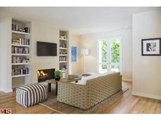 The beautiful shelving makes this home's study really pop. Malibu, CA Coldwell Banker Residential Brokerage $14,500,000
