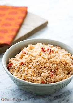My mother's signature Spanish rice recipe, a delicious accompaniment to steak, chicken, and Mexican entrees such as tacos or enchiladas ~ SimplyRecipes.com