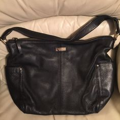 Pre-Loved!!!! Kate Spade Black Leather bag REDUCED!!!! Excellent condition!!! Leather is in great condition. Gold hardware, black and white striped interior with 2 inside pockets, zippered compartment and 2 outside pockets. Approximate measurements L10 1/2 x W12 1/2 x D8 1/2 kate spade Bags Hobos