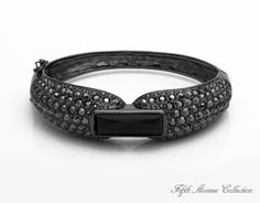 Invitation to Dance features a large Swarovski baguette crystal accompanied by over a hundred sparkling rounds. Comes in both black and silver. #bracelet #jewellery #fashionjewellery #cuff #cuffbracelet #blackbracelet