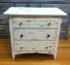 Beautiful 3 drawers dresser/ nightstand hand painted in white with distressed finish and black dry brush to give a weathered look . LOVE script writing in French is found on the top and front of this vintage-style dresser, makes this piece unique and one ... - $195.00