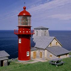 Red Hot The Pointe à la Renommée Light is a bright, cast-iron addition to the coast of Canada. The current tower was built in 1907 near L'Anse―Valleau on Quebec's Gaspé Peninsula. It stands at 49 feet with an adjacent museum/gift shop. Province Du Canada, Lighthouse Lighting, Lighthouse Pictures, Beacon Of Light, Light Of The World, Water Tower, Coastal Living, Quebec, Around The Worlds