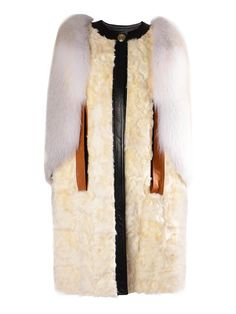 Givenchy Shearling and Fur Cape, $13,659; matchesfashion.com    - ELLE.com