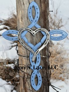 This beautiful horseshoe cross measures appox 16x12 with a heart in the middle. It is made completely of new horseshoes. Each cross is handmade and may vary slightly in looks