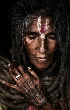 Namaste  - This woman seems as if her life's past is etched into her old age by her hair & skin. #tcarter2012