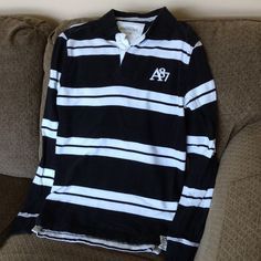 For the guy in your life..Aeropostale Polo Aeropostale men's long sleeve polo. Black/white stripes. Excellent condition. Aeropostale Tops