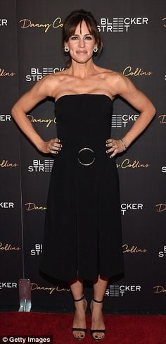 Showing off: The 42-year-old looked stunning in a strapless black dress that displayed smooth skin and decolletage