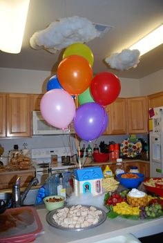 Disney-Pixar's UP birthday party decor - clouds made with crafter's stuffing and a tiny house centerpiece with balloons!