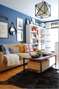 Homey Family Room Inspiration (use bright eclectic pillows on a neutral couch ... bookshelves to store toys, books, and media ... coffee table with storage space)