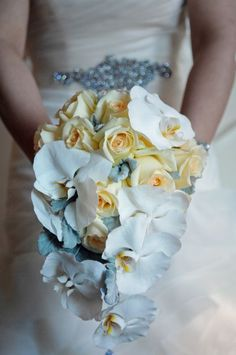 Love the teardrop shape. pale yellow roses, white orchids, dusty miller  Found on Weddingbee.com Share your inspiration today!