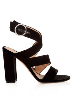 Gianvito Rossi's black velvet Rylee sandals are the perfect match to the season's midi-length hems.