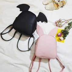 "Fabric material:pu. There are three pairs of ears. Color:pink,grey,black,dark green, Size: Height:24cm/9.36"". Width:20cm/7.80"". Thick:11cm/4.29""."