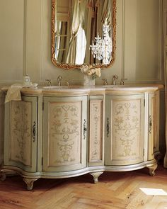Fabulous French dresser converted to a double sink for the bathroom.