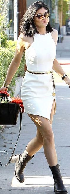 White wrap dress, cat sunglasses, black ankle boots, black tote handbag, and gold belt
