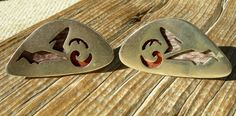 """large 'pluma azteca' design number 89 cufflinks by Los Castillo circa 1960s - measure 23mm by 42mm and the pair weigh 29 grams total - marked """"Pluma Azteca 89"""" and """"Hecho en Mexico"""" and """"Los Castillo Taxco"""" in a circle."""