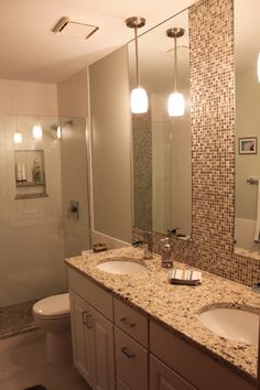 Hotel inspired designs for Teen Girl's Bathroom by Design Extra, LLC Long skinny mirrors, pendant light fixtures, granite countertop, mosaic tile backsplash. Contemporary, neutral, dramatic.