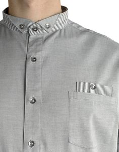 Grey button-up shirt, detail.
