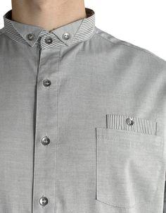 Grey button-up shirt, detail.