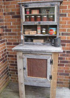 $250.  Reclaimed barnwood.  100 yr old tin on door.