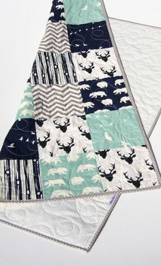 "Adorable modern boy quilt, in navy grey and mint with bucks, deer, chevron, bears, birds in flight and a woodland forest theme throughout. You can choose the size baby (34""x41"") or toddler (34""x54"")."