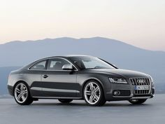 AUDI S5, in white with black rims and tinted windows, please :)