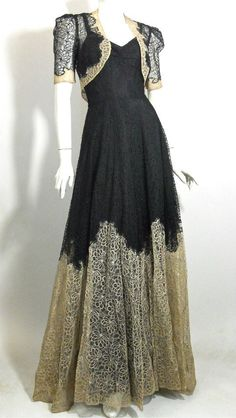 Late 30s gown of black and ecru embroidered lace with full skirt, full length underdress and cropped bolero