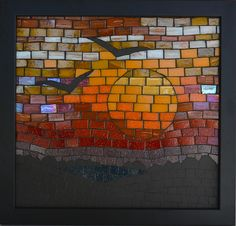 """Mosaic News from Kate Rattray. This is """"Beyond the Darkness"""". It is made with vitreous glass tile and ceramic tile. Approx 28cm × 28cm including the frame."""