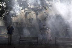 June 1, 2013. Protestors run away from tear gas at Gezi Park in Istanbul after clashes with riot police during a demonstration against the demolition of the park.